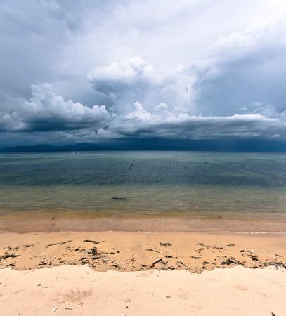furor: Storm clouds rising in tropical sand beach nusa lembongan bali indonesia