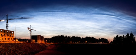 atmospheric phenomena: Beautiful noctilucent clouds glowing at night sky panorama Stock Photo