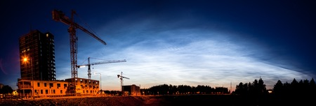 atmosphere construction: Beautiful noctilucent clouds glowing at night sky panorama Stock Photo