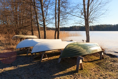 rowboats: Rowboats in winter storage at sunny spring morning