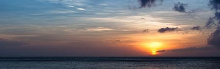 the setting sun: Setting sun over ocean horizon panorama view Stock Photo