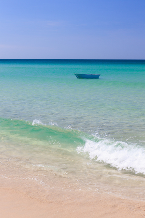 fisher: Fisher boat and clear turquoise water at daytime