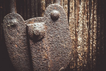 hasp: Closeup of a very old rustic padlock on a wooden door. Stock Photo