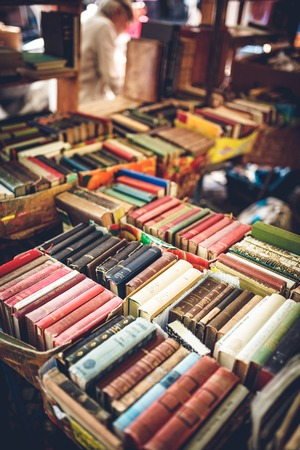 flea market: Old books for sale at flea market outdoors Stock Photo
