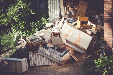 Funny broken furnitures trash pile at yard