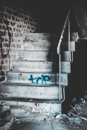 abandoned warehouse: Creepy staircase in abandoned warehouse