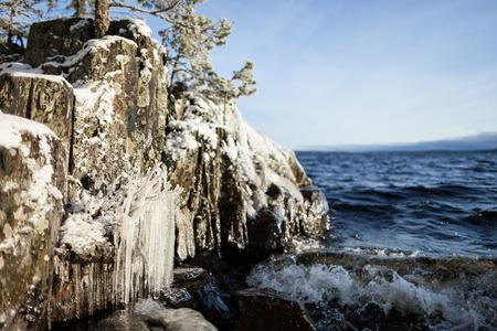 lakefront: Frozen lakefront rock cliff at sunrise light