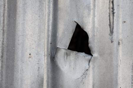 corrugated metal: Cut in corrugated metal sheet close-up