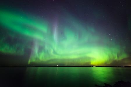northern lights: Beautiful northern lights aurora borealis over lake in finland Stock Photo