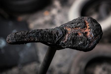 Burned bicycle saddle detail