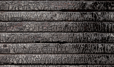 Gebrand gebroken houten muur achtergrond structuur Stockfoto