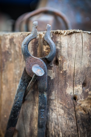 medieval blacksmith: Worn old iron pliers closeup Stock Photo