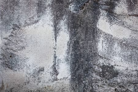 worn: Worn grey cement stone wall background texture Stock Photo