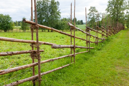 split rail: Old traditional wooden fence and meadow in finland
