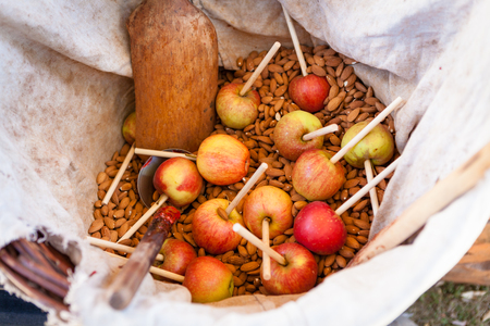 apple sack: Candy apples waiting to be prepared in bag with almonds