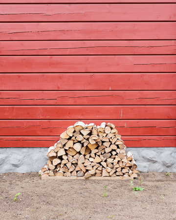 stored: Firewood pile stored outside house Stock Photo
