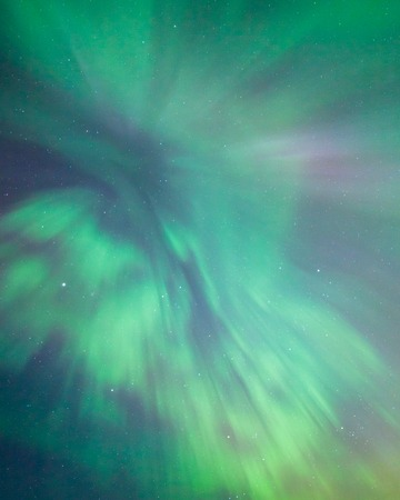 ionosphere: Northern lights corona above in the sky Stock Photo