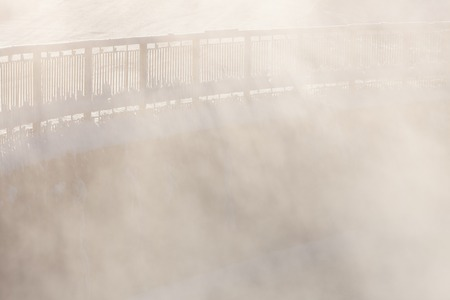 evaporate: Railing in cold winter morning fog