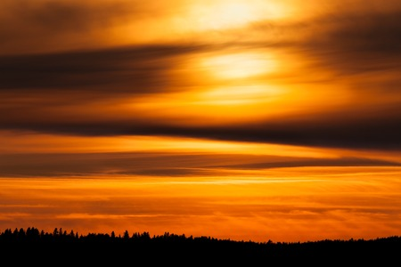 telephoto: Fiery sunset background taken with telephoto lens Stock Photo