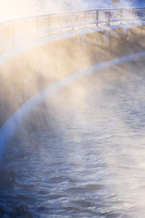 evaporate: Water vapor illuminated by sunlight at cold winter day