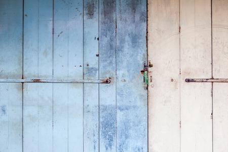 worn: Worn messy old wooden door locked