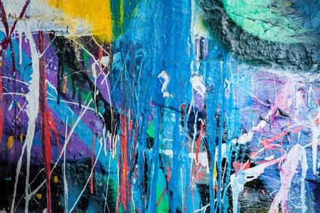 splashed: Dripping paint graffiti wall background Stock Photo