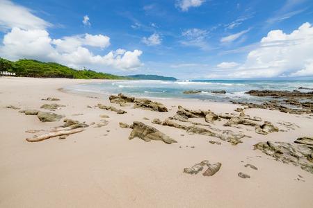 playa: Waves sand beach and clouds sunny day on playa santa teresa costa rica