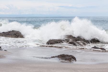 waves crashing: Waves crashing to rocks montezuma beach Costa Rica