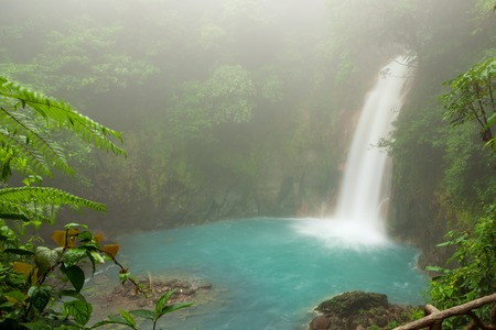 cerulean: Rio celeste waterfall at foggy day