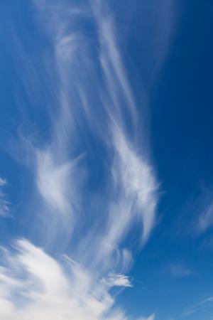 Wispy cirrus clouds blue sky