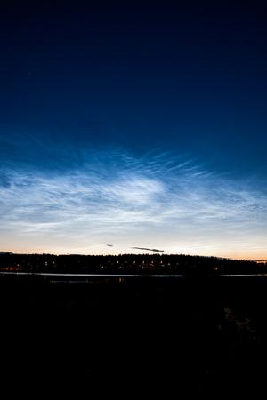 atmospheric phenomena: Noctilucent clouds at night sky Stock Photo