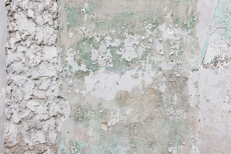 Aged white concrete wall with cracked plaster background Stock Photo