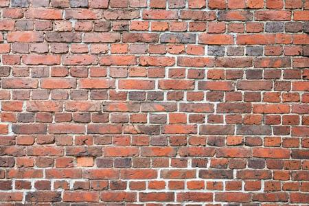 Alter abgenutzter Backsteinmaueraußenmusterbeschaffenheitshintergrund Standard-Bild