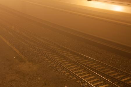 Railroad near train station at foggy night 스톡 콘텐츠