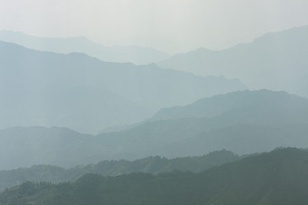 Landscape layers mountains in haze at Longshen China