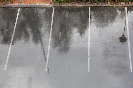 Empty parking lot in rain