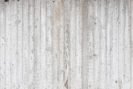 Fondo grigio a strisce di struttura del muro di cemento