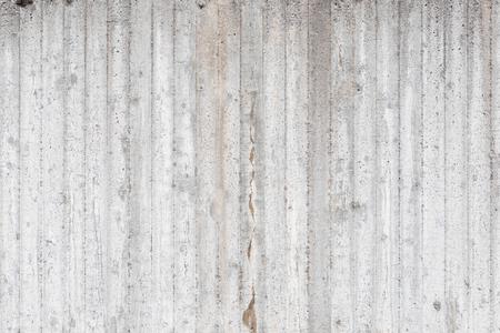 Gestreifter grauer Betonwandbeschaffenheitshintergrund
