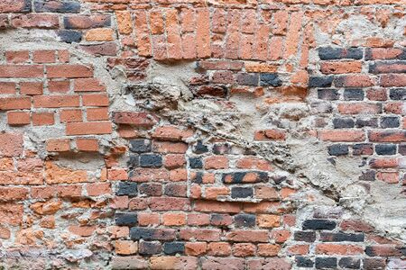 Old damaged worn brick wall texture background