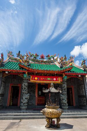 chinese temple roofs and dramatic clouds and deep blue sky Standard-Bild