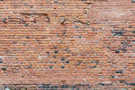 Old damaged worn brick wall texture background