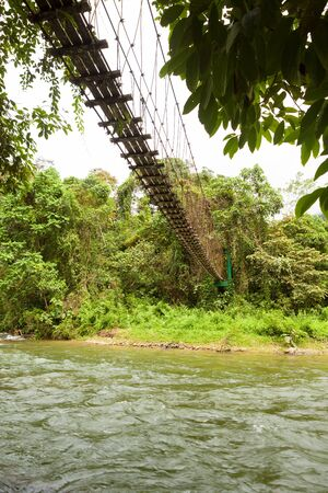 Suspension bridge over river in Gunung Mulu national park broneo Malaysia