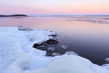 Lake shore scenery at dusk winter in Finland Фото со стока