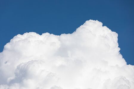 Fluffy cloud edge and blue sky cloudscape background
