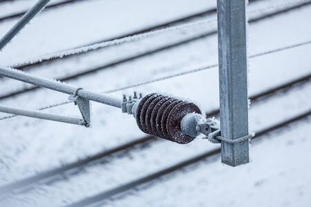 Overhead power line close-up at cold winter day