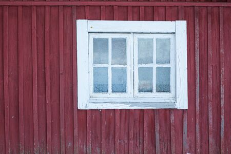 Old shed frozen window and wall at winter in Finland