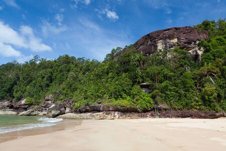 Exotic sand beach and cliffs with forest borneo malaysia