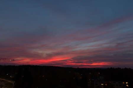 Red clouds sunset sky landscape at dusk