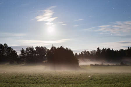 Foggy night and moonlight in countryside Finland