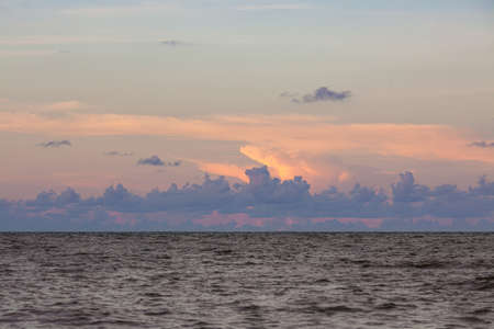 Sunset clouds sky and sea scape